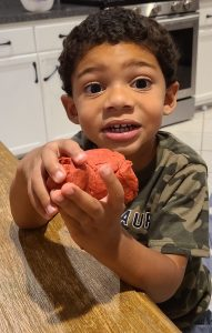 boy playing with play-doh