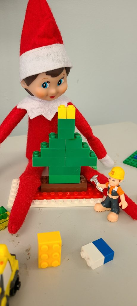 elf on the shelf playing with legos