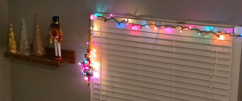 elf on the shelf tangled in lights