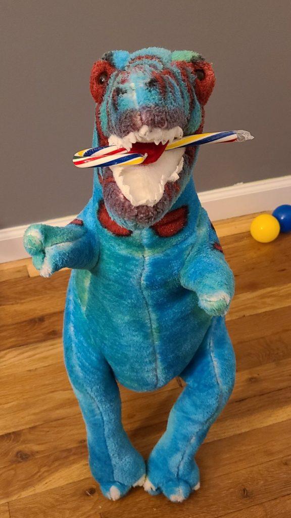 dinosaur eating a candy cane