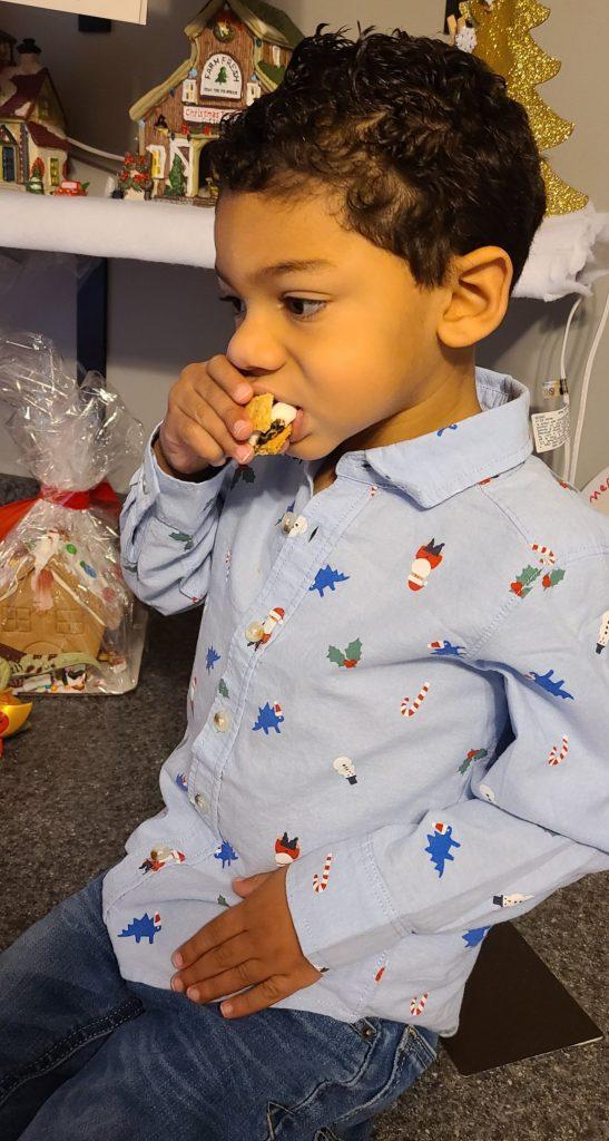 boy eating a smore